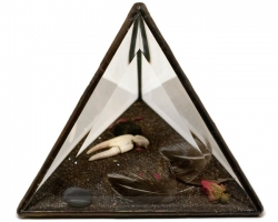 The Wild UnknownBlack Prism8 x 8 x 8 in. Glass, sand, charcoal, stones, rose, claw, feathers. 2010