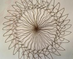 """Jepoy GarciaHanger Kaleidoscope  Approx 30"""" diameter. Metal hangers, nails. 2012"""