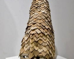 "Noel MiddletonJaga's Abecedarians (Sun)18 "" tall. Wood, Mixed Media. 2009"