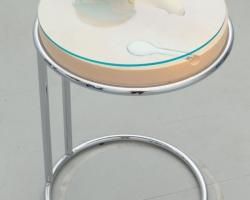 "Nikki Woolsey Aside the table, 2014 2.5' x 14"" Metal, glass, foam, ceramic."