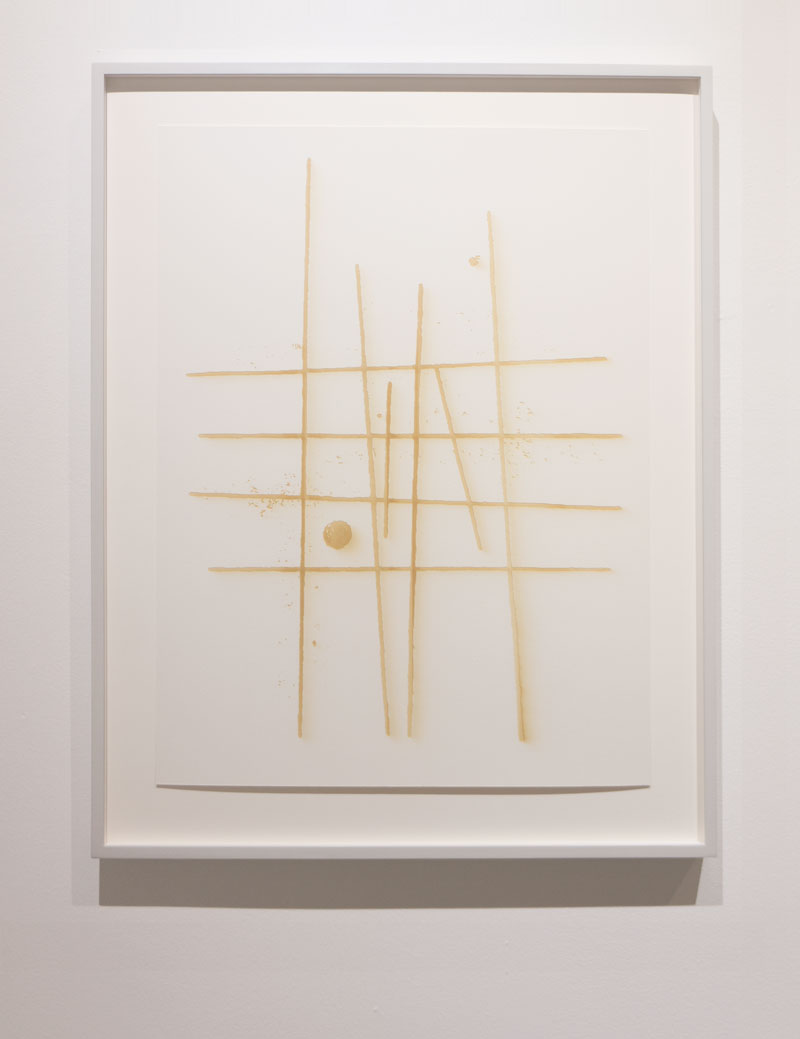 Artwork on display. Floating , museum glass, light grey wood frame.