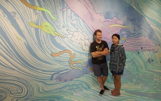 Dan and Kozue Kitchens (of Kozyndan) in front of mural at the Japanese American National Museum (photo courtesy of Giant Robot)